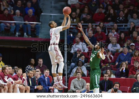 PHILADELPHIA - JANUARY 31: Temple Owls guard Jesse Morgan (3) shoots a three pointer in the AAC conference college basketball game January 31, 2015 in Philadelphia.  - stock photo