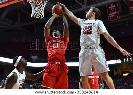 PHILADELPHIA - JANUARY 2: Temple Owls guard Mike Robbins (22) blocks a shot during the American Athletic Conference basketball game January 2, 2016 in Philadelphia.  - stock photo