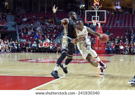 PHILADELPHIA - JANUARY 4: Temple Owls guard Quenton DeCosey (25) drives to the basket during the American Athletic Conference basketball game January 4, 2015 in Philadelphia.