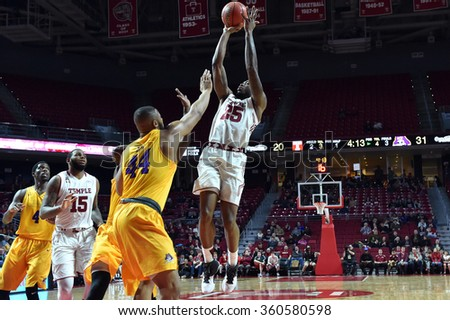 PHILADELPHIA - JANUARY 9: Temple Owls guard Quenton DeCosey (25) takes a jump shot during the American Athletic Conference  basketball game January 9, 2016 in Philadelphia.  - stock photo