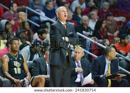 PHILADELPHIA - JANUARY 4: UCF Knights head coach Donnie Jones calls out from the bench during the American Athletic Conference basketball game January 4, 2015 in Philadelphia.