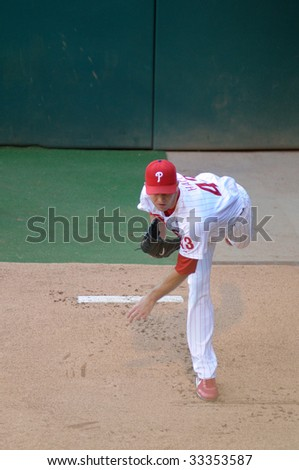 PHILADELPHIA - JULY 7: Philadelphia Phillies pitcher J.A. Happ warms up in the bullpen prior to a game July 7, 2009 in Philadelphia.