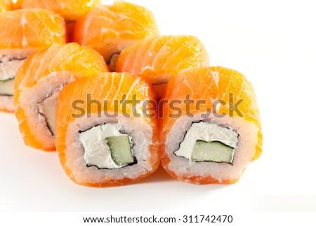 Philadelphia Maki Sushi made of Cream Cheese and Cucumber inside. Salmon outside - stock photo