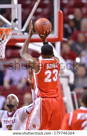 PHILADELPHIA - MARCH 1: Houston Cougars forward Danuel House (23) takes a jumper during the AAC basketball game March 1, 2014 in Philadelphia.  - stock photo