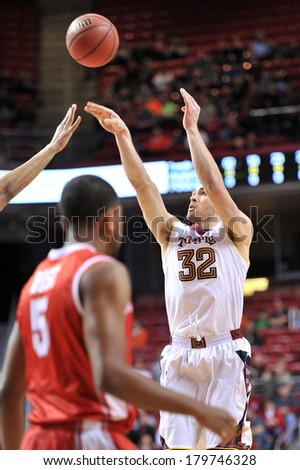 PHILADELPHIA - MARCH 1: Temple Owls guard Dalton Pepper (32) shoots a jumper during the AAC basketball game March 1, 2014 in Philadelphia.