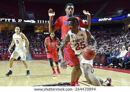 PHILADELPHIA - MARCH 25: Temple Owls guard Quenton DeCosey (25) drives to the basket during the NIT quarterfinal basketball game March 25, 2015 in Philadelphia. - stock photo
