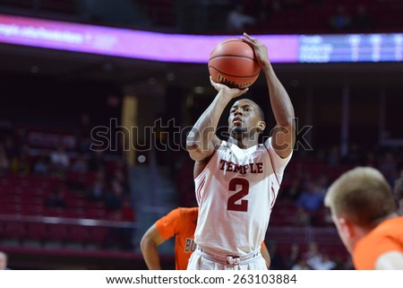 PHILADELPHIA - MARCH 18: Temple Owls guard Will Cummings (2) shoots a free throw during the NIT first round basketball game March 18, 2015 in Philadelphia. - stock photo