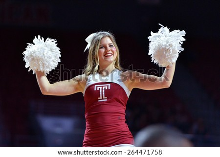 PHILADELPHIA - MARCH 25: The Temple University cheerleaders perform during the NIT quarterfinal basketball game March 25, 2015 in Philadelphia. - stock photo
