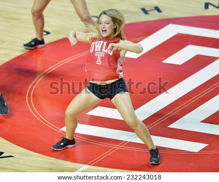 PHILADELPHIA - NOVEMBER 17: A Temple Diamond Gem (dance team) performs on the court during the NCAA basketball game November 17, 2014 in Philadelphia.