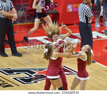 PHILADELPHIA - NOVEMBER 25: Members of the Temple cheerleading squad perform during the Big 5 basketball game November 25, 2014 in Philadelphia.