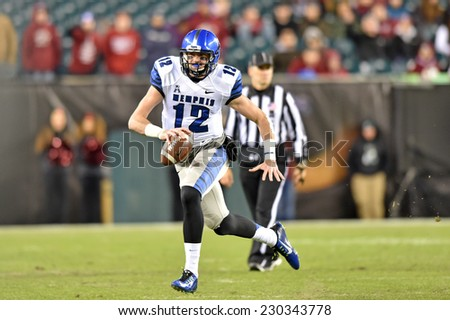 PHILADELPHIA - NOVEMBER 8: Memphis Tigers quarterback Paxton Lynch (12) scrambles on a quarterback keeper during the AAC football game November 8, 2014 in Philadelphia, PA.  - stock photo