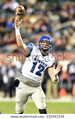 PHILADELPHIA - NOVEMBER 8: Memphis Tigers quarterback Paxton Lynch (12) throws a pass during the AAC football game November 8, 2014 in Philadelphia, PA.  - stock photo
