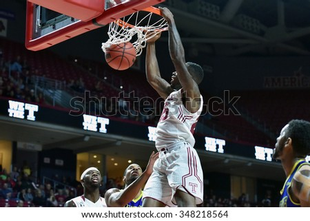 PHILADELPHIA - NOVEMBER 29: Temple Owls guard Quenton DeCosey (25) finishes a slam dunk during a NCAA basketball game November 29, 2015 in Philadelphia.