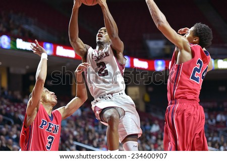 PHILADELPHIA - NOVEMBER 25: Temple Owls guard Will Cummings (2) glides in for a lay-up attempt during the Big 5 basketball game November 25, 2014 in Philadelphia.