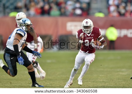 PHILADELPHIA - NOVEMBER 21: Temple Owls running back David Hood (24) runs with the ball in the open field during the AAC football game November 21, 2015 in Philadelphia.  - stock photo