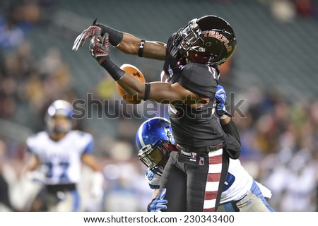 PHILADELPHIA - NOVEMBER 8: Temple Owls wide receiver Nate Hairston (15) can not control a long pass during the AAC football game November 8, 2014 in Philadelphia, PA.  - stock photo