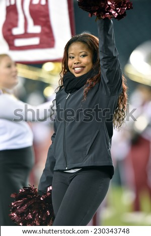PHILADELPHIA - NOVEMBER 8: The Temple Owls dance team performs during the AAC football game November 8, 2014 in Philadelphia, PA.  - stock photo