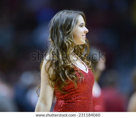 PHILADELPHIA - NOVEMBER 14:  The Temple Owls spirit squad performs during the season opening ladies basketball game against LaSalle November 14, 2014 in Philadelphia.  - stock photo