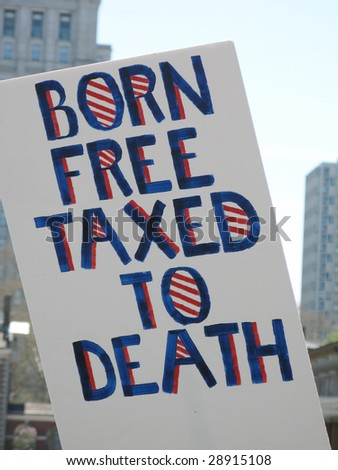 PHILADELPHIA, PA- APR 18: A protester carries a placard during tea party protest April 18, 2009 in Philadelphia. The protest is a modern-day protest to the government's spending of billions of dollars