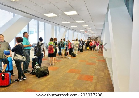 PHILADELPHIA, PA- 22 JUNE 2015- Passengers wait in line at the TSA security check at the Terminal A at the Philadelphia International Airport (PHL). - stock photo