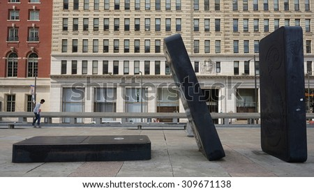 PHILADELPHIA, PA - MAY 9: Dominoes at Your Move Board Game Art Park in Philadelphia, as seen on May 9, 2015. Scattered on the Municipal Services Building plaza are oversized game pieces. - stock photo