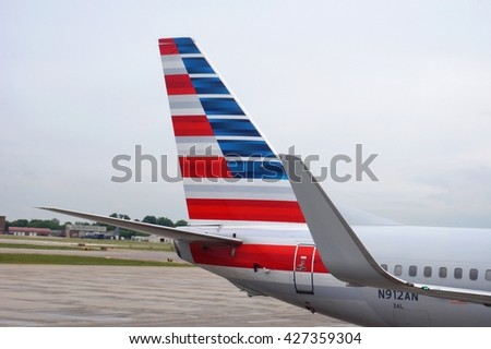 PHILADELPHIA, PA -25 MAY 2016- The new American Airlines (AA) colors on the tail of a plane at the Philadelphia International Airport (PHL). - stock photo