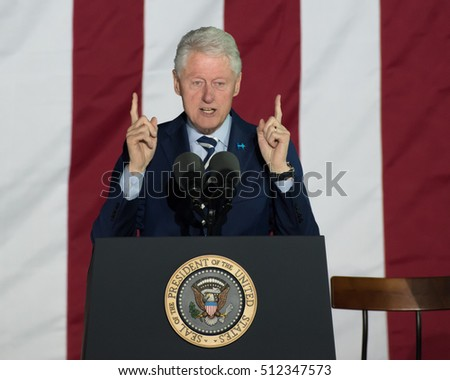 PHILADELPHIA, PA - NOVEMBER 7, 2016: Bill Clinton former US president gestures fingers pointed up as he delivers a speech at a campaign rally for Hillary Clinton the Democratic Presidential nominee.