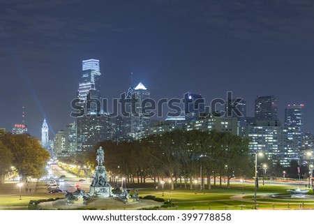 PHILADELPHIA, PA - NOVEMBER 2012: Philadelphia night skyline and Benjamin Franklin Parkway from the Philadelphia Art Museum - stock photo