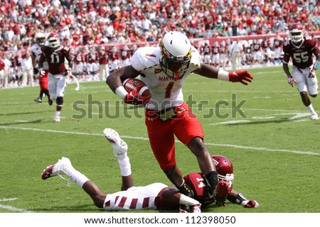 PHILADELPHIA, PA. - SEPTEMBER 8: Maryland quarterback #1 Stefon Diggs runs for the sidelines after making a catch against Temple  on September 8, 2012 at Lincoln Financial Field in Philadelphia, PA. - stock photo