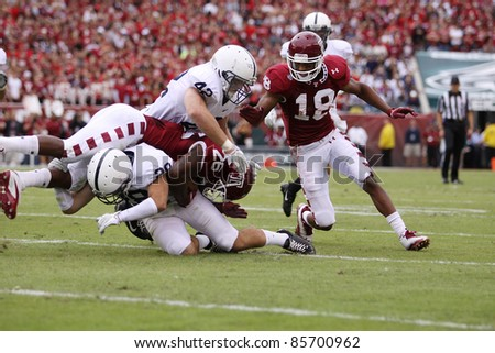 PHILADELPHIA, PA. - SEPTEMBER 17: Penn State defenders Michael Mauti  and Drew Astorino make a tackle against Temple on September 17, 2011 at Lincoln Financial Field in Philadelphia, PA. - stock photo