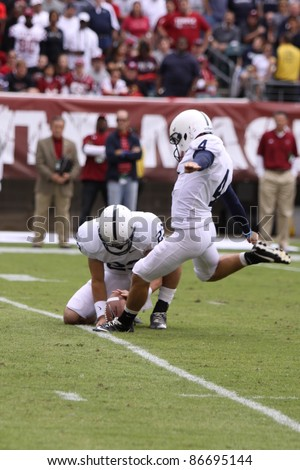 PHILADELPHIA, PA. - SEPTEMBER 17: Penn State kicker Evan Lewis follows through on a kick during a game against Temple on September 17, 2011 at Lincoln Financial Field in Philadelphia, PA. - stock photo