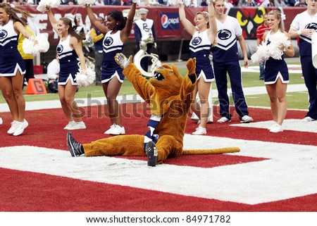 PHILADELPHIA, PA. - SEPTEMBER 17: Penn State mascot the Nittany Lion celebratesafter a touchdown  during a game against Temple on September 17, 2011 at Lincoln Financial Field in Philadelphia, PA. - stock photo
