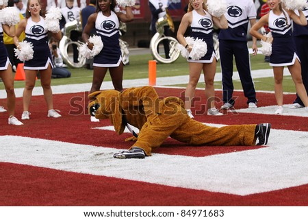 PHILADELPHIA, PA. - SEPTEMBER 17: Penn State mascot the Nittany Lion does push-ups after a touchdown  during a game against Temple on September 17, 2011 at Lincoln Financial Field in Philadelphia, PA. - stock photo