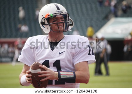 PHILADELPHIA, PA. - SEPTEMBER 17: Penn State quarterback Matt McGloin warms up before a game against Temple on September 17, 2011 at Lincoln Financial Field in Philadelphia, PA. - stock photo