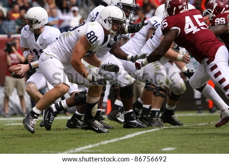 PHILADELPHIA, PA. - SEPTEMBER 17: Penn State quarterback Matthew McGloin moves to hand the football off in a game against Temple on September 17, 2011 at Lincoln Financial Field in Philadelphia, PA. - stock photo