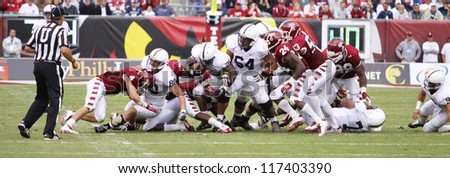 PHILADELPHIA, PA. - SEPTEMBER 17: Penn State running back Silas Redd runs off tackle against Temple on September 17, 2011 at Lincoln Financial Field in Philadelphia, PA. - stock photo