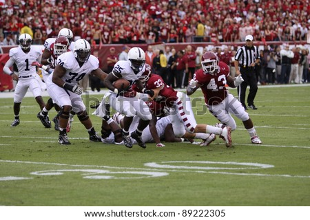 PHILADELPHIA, PA. - SEPTEMBER 17: Penn State running back Silas Redd runs off tackle during a game against Temple on September 17, 2011 at Lincoln Financial Field in Philadelphia, PA. - stock photo