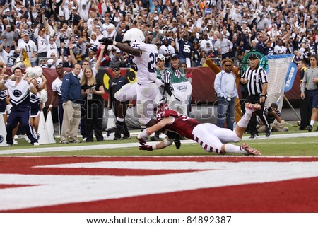 PHILADELPHIA, PA. - SEPTEMBER 17: Penn State running back Silas Redd scores a touchdown  against Temple on September 17, 2011 at Lincoln Financial Field in Philadelphia, PA. - stock photo