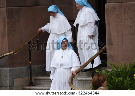 PHILADELPHIA, PA - SEPTEMBER 26 2015: Pope Francis arrived at the Cathedral Basilica of Peter and Paul in downtown Philadelphia to celebrate mass. Nuns emerge from Basilica after mass - stock photo