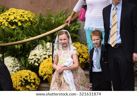 PHILADELPHIA, PA - SEPTEMBER 26 2015: Pope Francis celebrated mass at the Cathedral Basilica of Peter & Paul in downtown Philadelphia. Children in the Sunday best clothes leave cathedral after Mass - stock photo