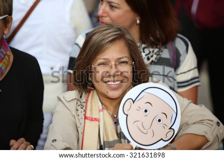 PHILADELPHIA, PA - SEPTEMBER 26 2015: Pope Francis celebrated mass at the Cathedral Basilica of Peter & Paul in downtown Philadelphia. Woman with papal caricature sign