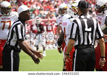 PHILADELPHIA, PA. - SEPTEMBER 8: Referees confer  before making a call during the Maryland / Temple game on September 8, 2012 at Lincoln Financial Field in Philadelphia, PA.