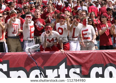 PHILADELPHIA, PA. - SEPTEMBER 8: Temple fans celebrate a good play during a game against Maryland September 8, 2012 at Lincoln Financial Field in Philadelphia, PA. - stock photo