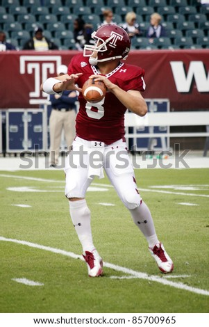 PHILADELPHIA, PA. - SEPTEMBER 17: Temple Quarterback Mike Gerardi drops back to pass during a game against Penn State on September 17, 2011 at Lincoln Financial Field in Philadelphia, PA. - stock photo