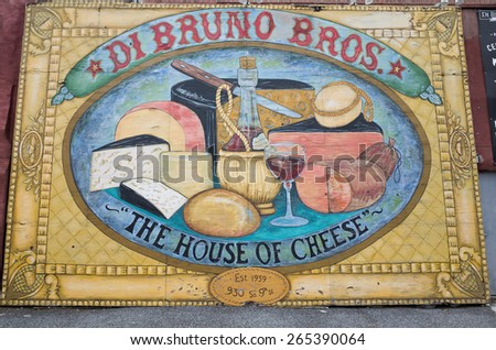 PHILADELPHIA, PA, USA-MARCH 30, 2015:  Street mural advertising the Di Bruno Bros. grocery store in the historic Italian Market.  The brothers were Italian immigrants in the 1930s. - stock photo