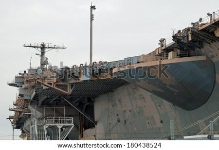 PHILADELPHIA, PENNSYLVANIA - February 16, 2014:   Decommissioned aircraft carrier USS John F. Kennedy at the NAVSEA Inactive Ships On-site Maintenance facility at the Philadelphia navy yard. - stock photo