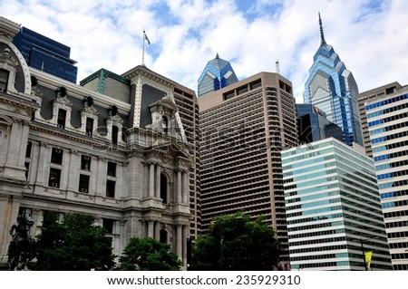 Philadelphia, Pennsylvania - June 25, 2013:  Philadelphia City Hall (left) and modern corporate office towers including 1 Liberty Plaza designed by Helmut Jahn (with spire) in Center City - stock photo