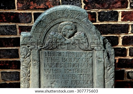 Philadelphia, Pennsylvania - June 25, 2013: 18th century tombstone with winged angel face stands by the entrance door at 1727-1754 Christ Church