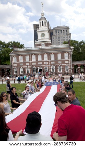 Philadelphia, Pennsylvania, USA - June 14, 2015: Tourist sightseeing in front of one of Amarica's most famous landmark, Independence Hall in Philadelphia, Pennsylvania on June 14, 2015 - stock photo