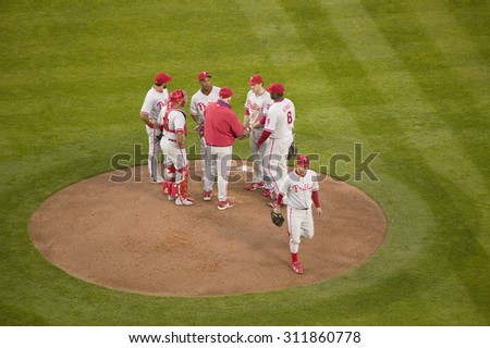 Philadelphia Phillies coach, pitcher and infielders meeting on mound during National League Championship Series (NLCS), Dodger Stadium, Los Angeles, CA on October 12, 2008